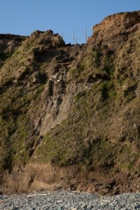 Many times, humans develop too close to cliff sides, and their homes and buildings are damaged when the cliff breaks apart.